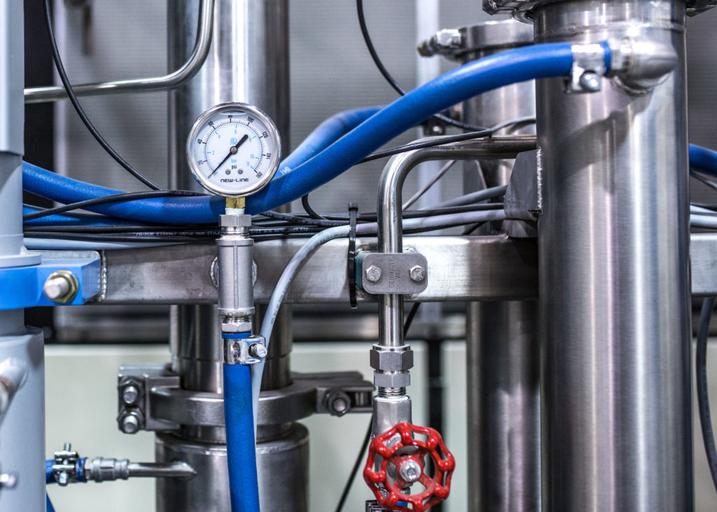 Closeup of Extraction Machinery Which Requires Strict Safety Standards
