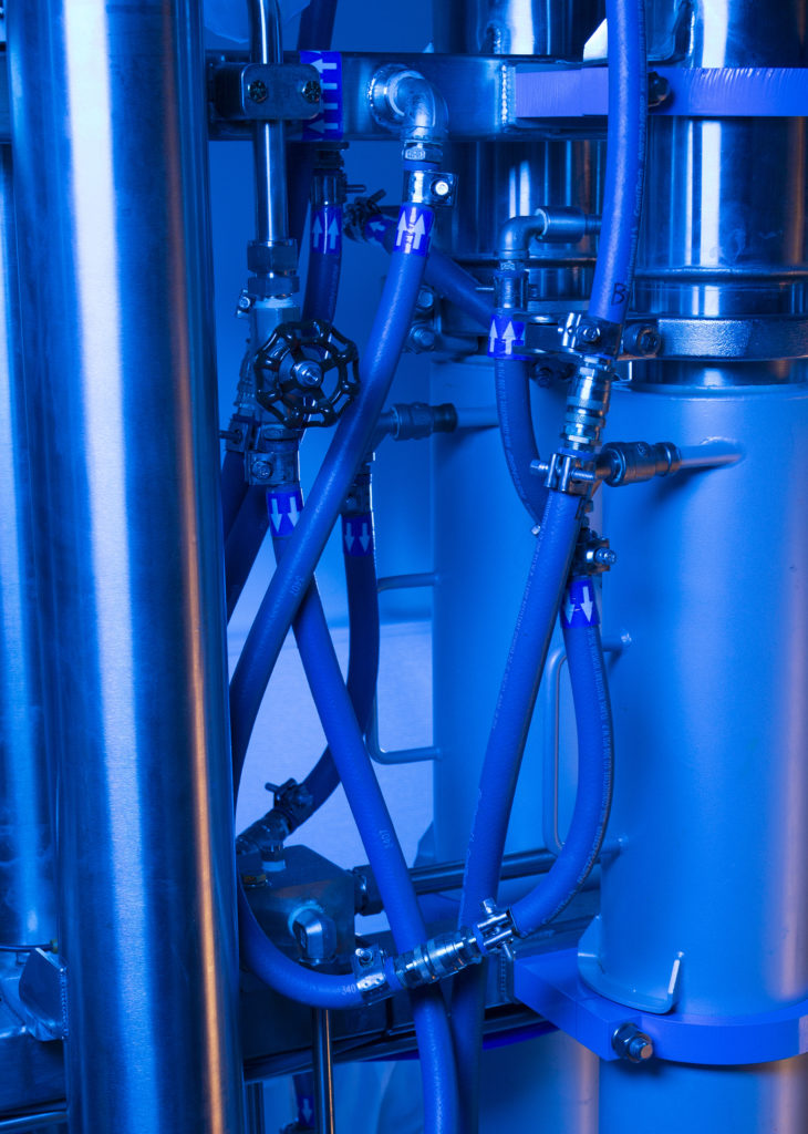 Valens Agritech cannabis extraction equipment with blue overlay