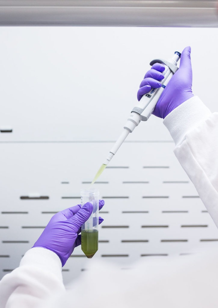 Valens lab technician closeup of hands, pipette, and vial; highlighting the importance of safety for formulating vape technology